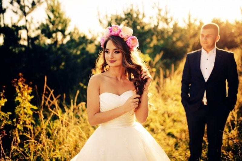 Beautiful bride with flowers on her head and wedding dress