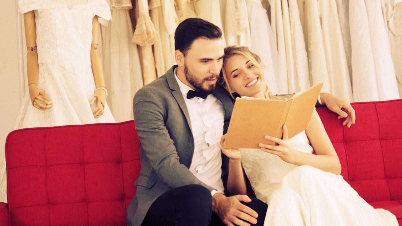 Bride and groom reading a book