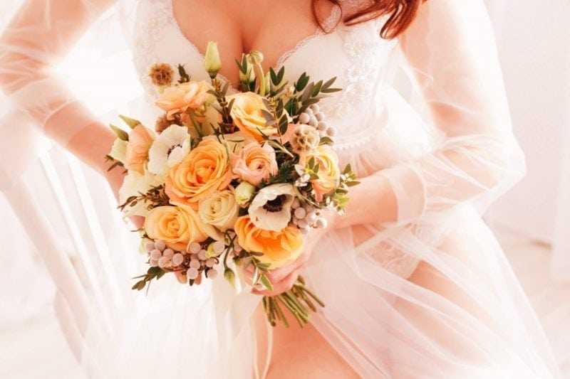 Bride with a bouquet big boobs wedding lingerie