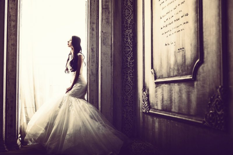 A young woman in her wedding dress