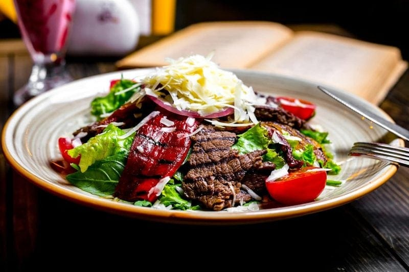 Front view grilled meat with vegetables lettuce grated cheese