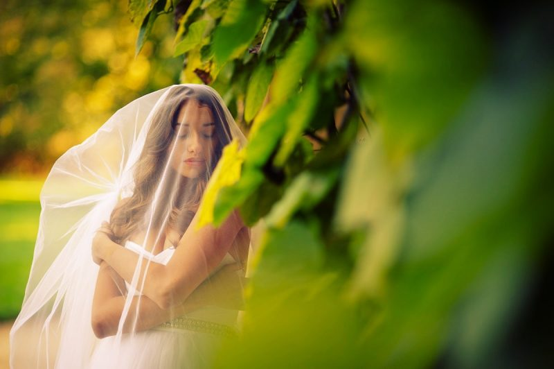 Sensual bride covered in veil