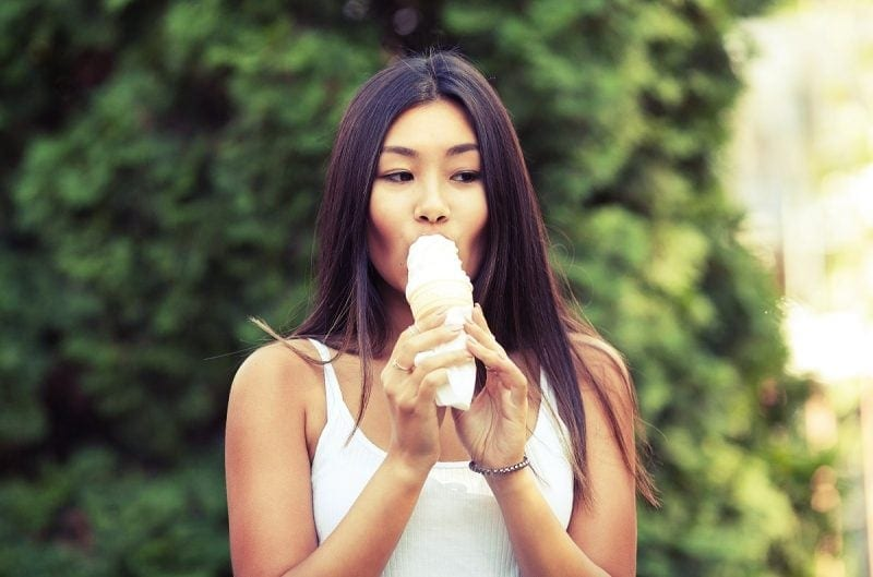 Asian woman eating ice cream
