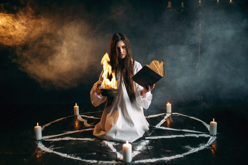 White witch in pentagram circle