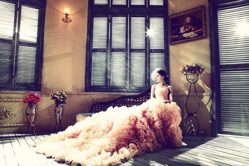 Beautiful woman with a huge wedding dress