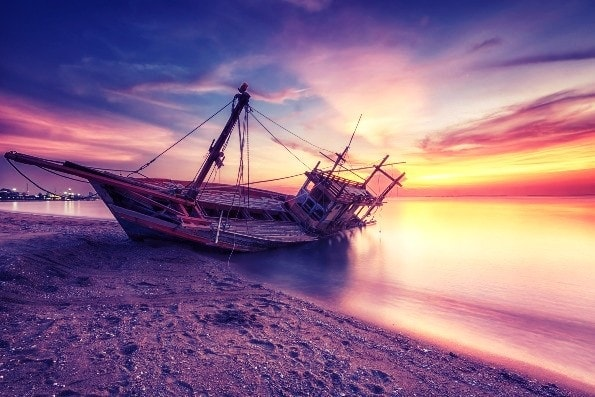 Shipwreck on beach twilight