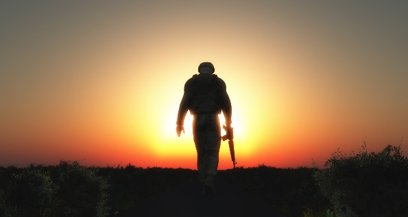 Soldier walking into the sunset