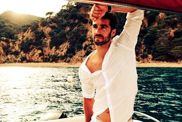 Handsome wealthy man on a boat
