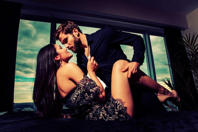 Hot woman initiating sex with a handsome man