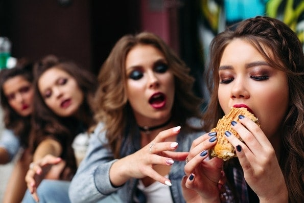 Four young women eating fast food