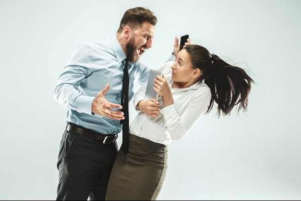Angry business manshouting at business woman