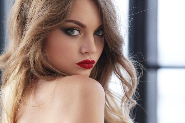 Beautiful woman big blue eyes looking in camera