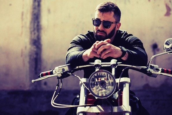 Handsome man with beard on motorcycle finding himself