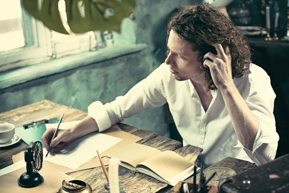 Man writing down his thoughts and designing a life for living with intention