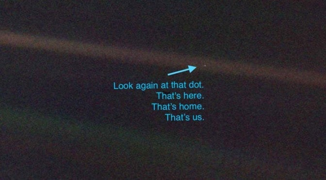 The pale blue dot image taken by the voyager spacecraft, 3.7 billion miles away from earth.