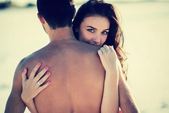 Stunning brunette hugging naked man