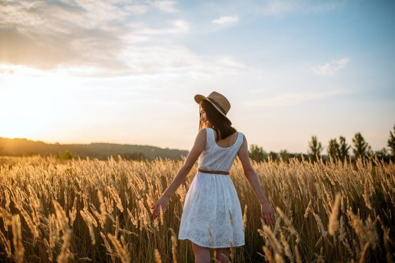 Beautiful woman in white dress in the countryside