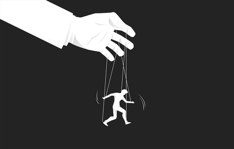Man being controlled like a puppet