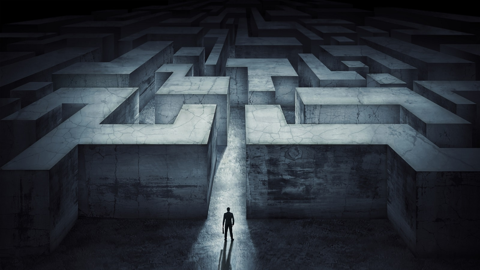 Businessman standing at the start of a maze