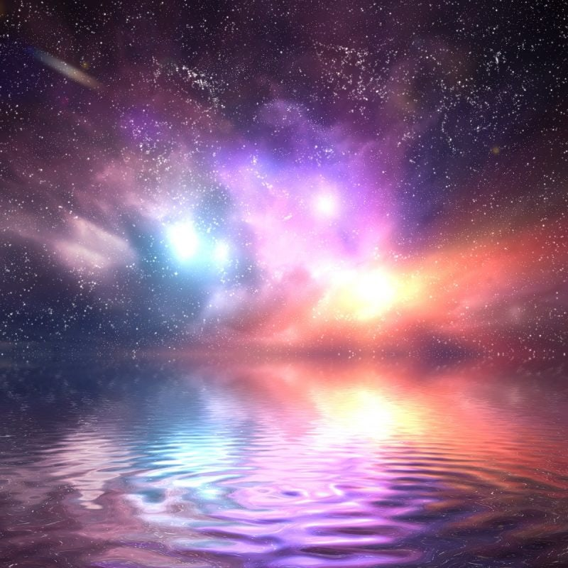 Ocean under galaxy sky. Stars, fantasy, water reflection