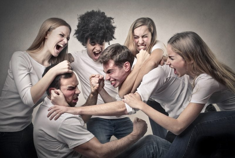 Group of men and women fighting each other no emotional discipline