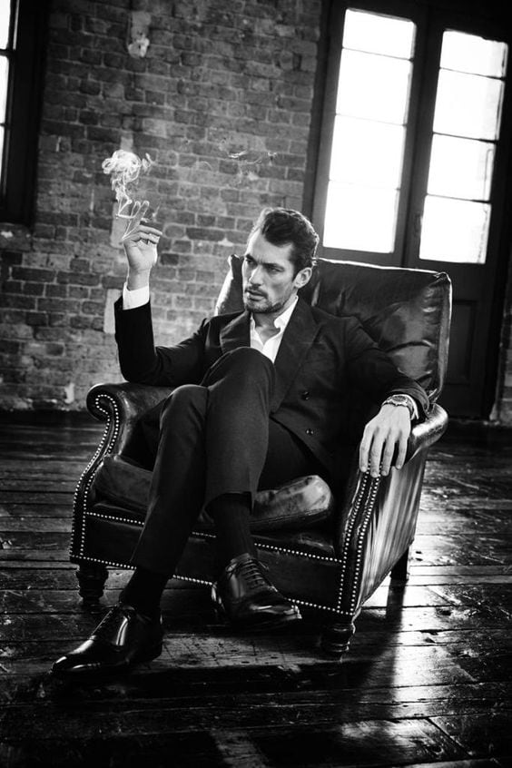 Handsome powerful man in a chair