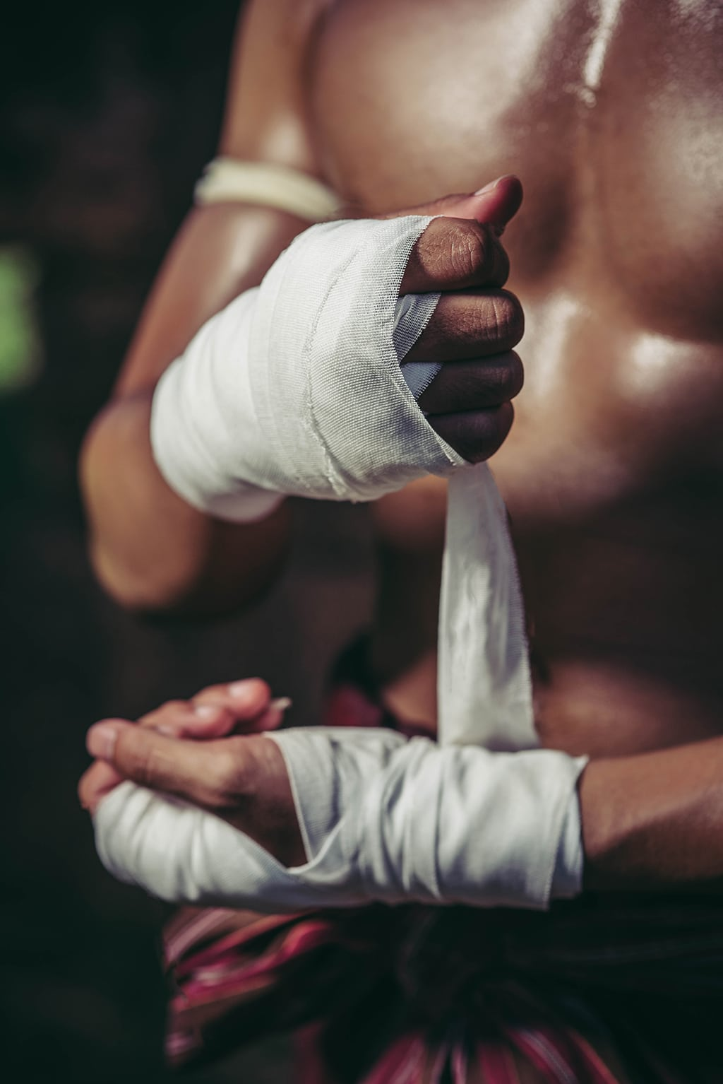 Boxer preparing fight with tape around his hands