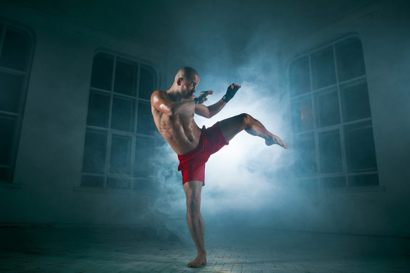 Young man kickboxing