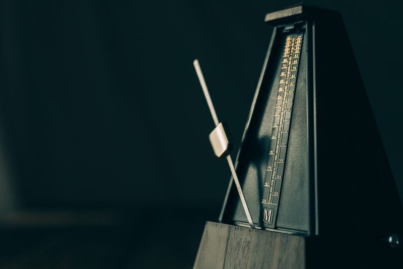 the principle of rhythm displayed with a metronome